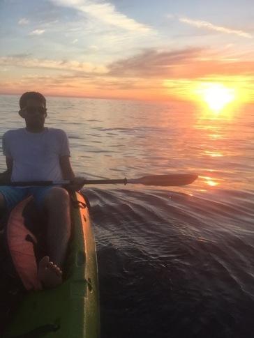 Connor, kayak, sunset.